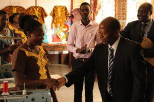 Hon. J.C Muyingo Congratulating a participant